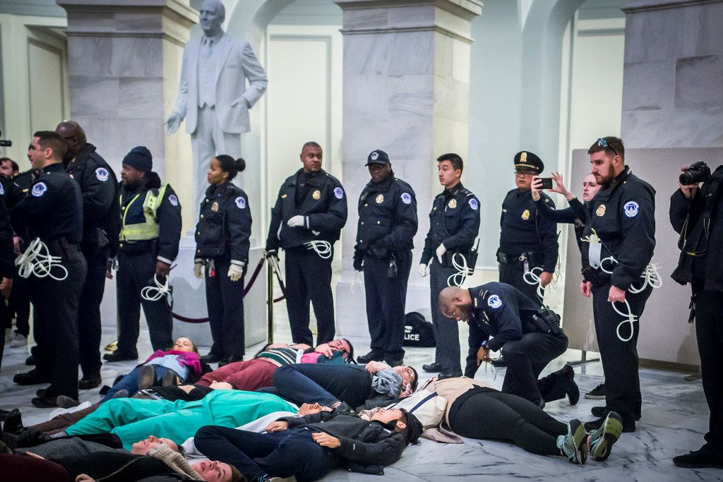"About 70 protesters against the GOP tax bill were arrested Monday while staging a ""die-in"" in the rotunda of the Rayburn House office building."