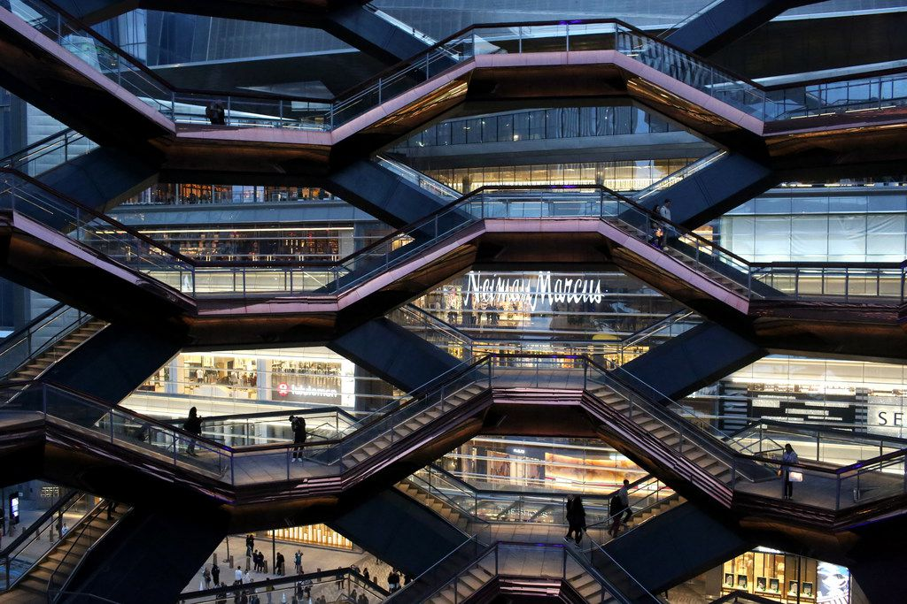People gather inside The Vessel, at the opening of Hudson Yards in Manhattan, New York on Friday.