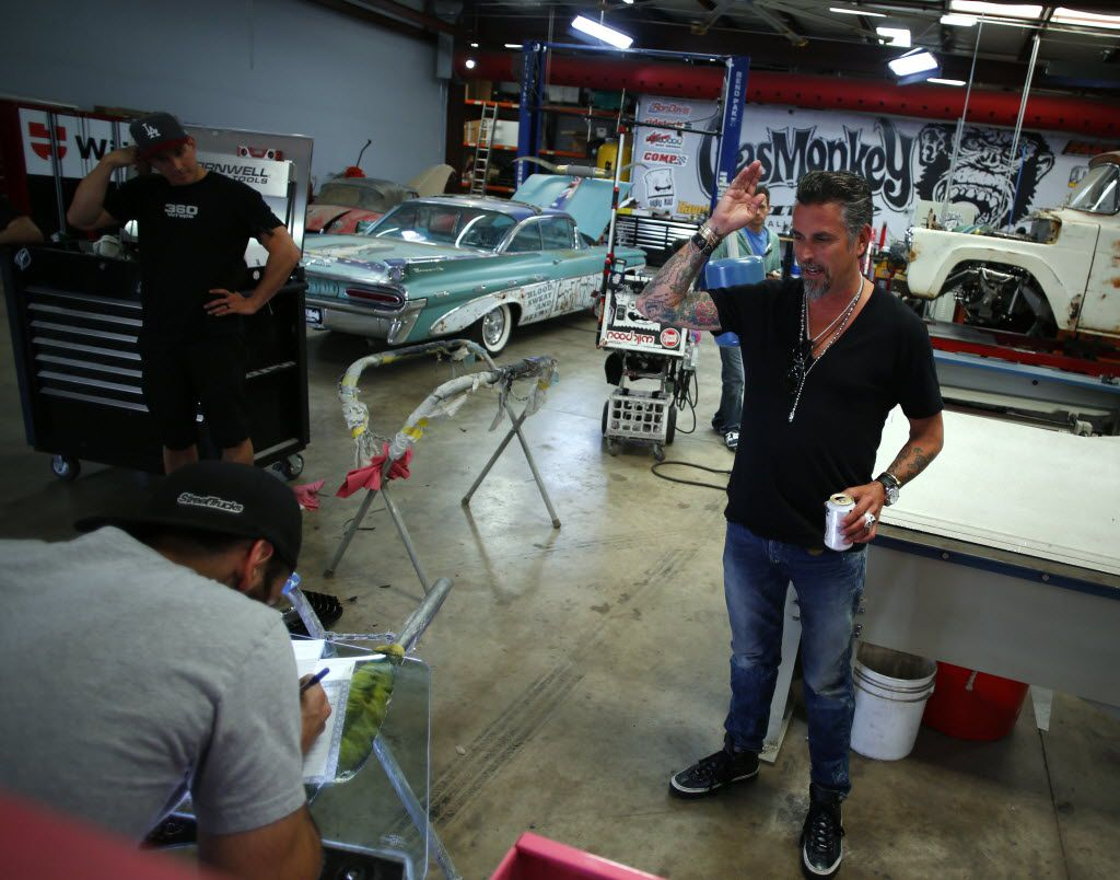 "Richard Rawlings, the star of cable TV show ""Fast N' Loud"" and the founder of the growing and greasy Gas Monkey, talks to his crew at his shop in Dallas in 2015."