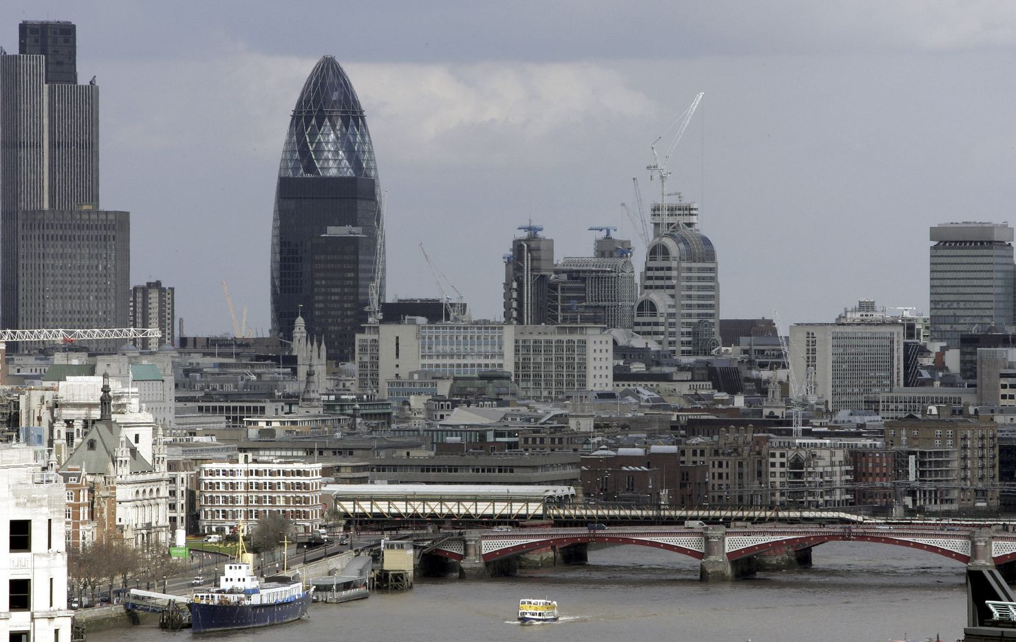"Foster + Partners' torpedo-shaped tower in London is nicknamed ""The Gherkin."""