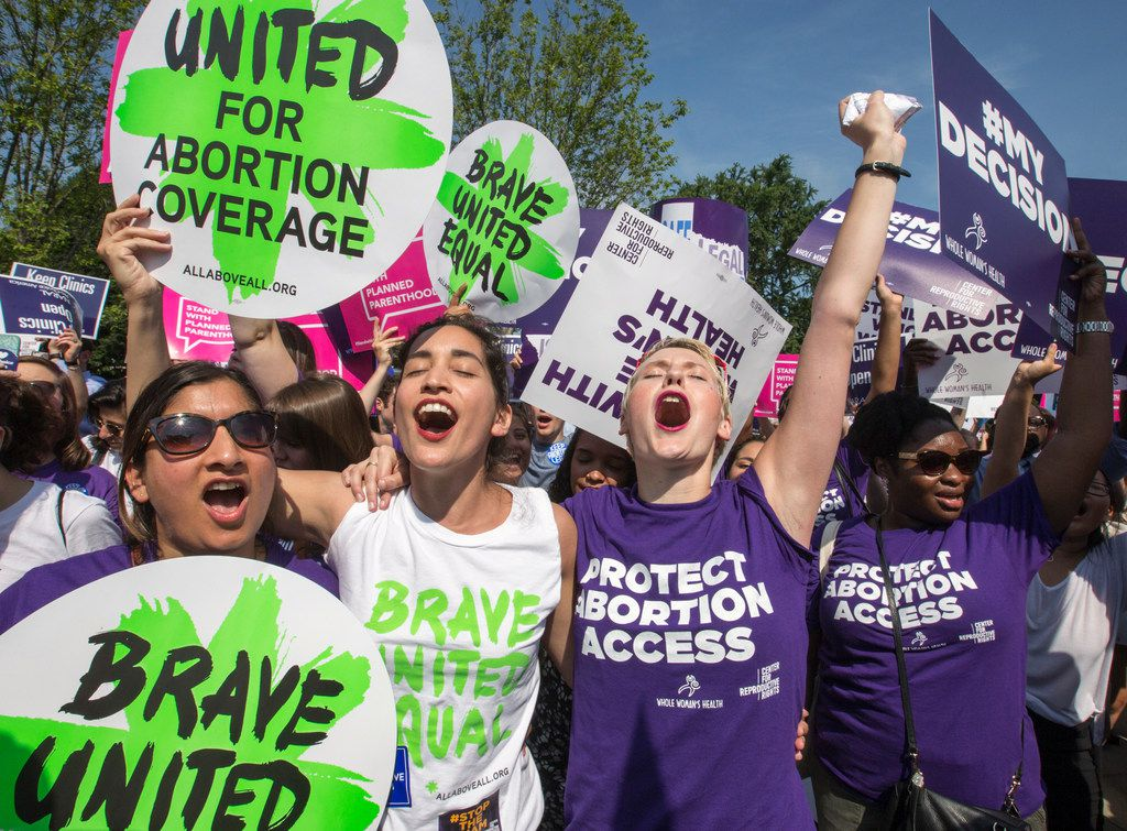 In this June 27, 2016, file photo, abortion rights activists rejoice in front of the Supreme Court in Washington as the justices struck down the strict Texas anti-abortion restriction law known as HB2. Texas abortion providers who won a landmark U.S. Supreme Court ruling in 2016 that blocked a new wave of anti-abortion efforts are now using that decision to try undoing laws on the books for decades in a lawsuit filed Thursday, June 14, 2018.