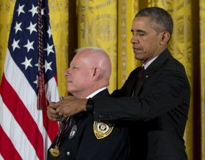 "Obama placed the medal around Stevens' neck during Monday's ceremony. The Medal of Valor is presented to those who ""exhibited exceptional courage, regardless of personal safety, in the attempt to save or protect human life."" (Carolyn Kaster/The Associated Press)"