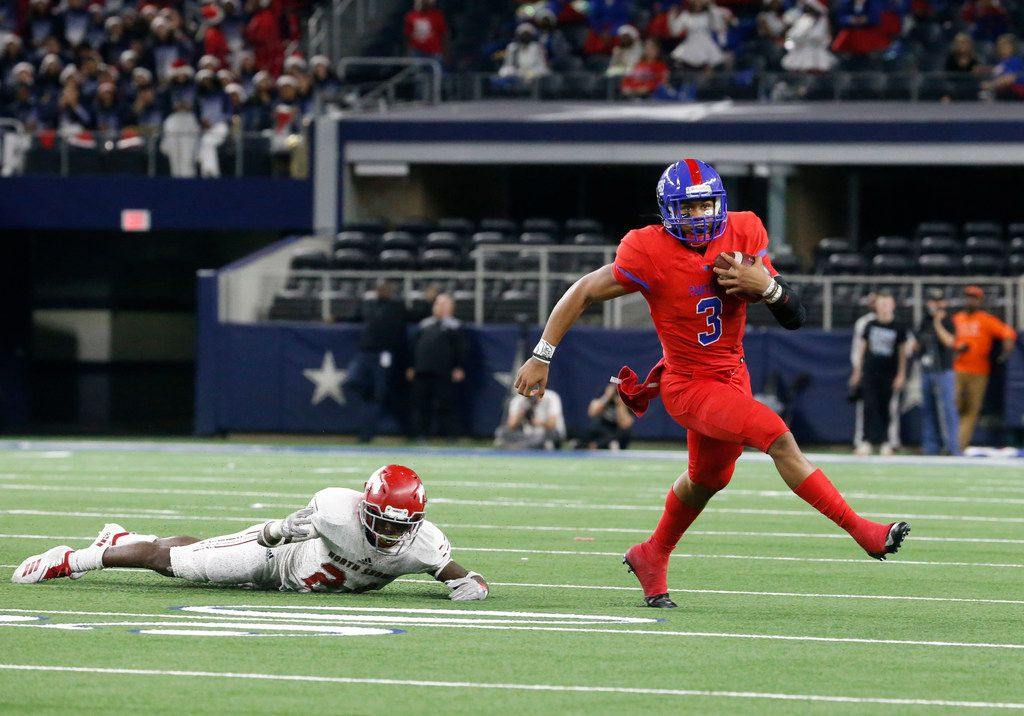 Duncanville's quarterback Ja'Quinden Jackson (3) runs the ball over an unidentified Galena Park player in the first half of their Class 6A Division I football state championship game at AT&T Stadium in Arlington, Texas on Dec 22, 2018.   (Nathan Hunsinger/The Dallas Morning News)