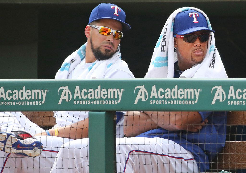 Texas Rangers Robinson Chirinos' left, and Adrian Beltre are pictured in the dugout during the Houston Astros vs. the Texas Rangers major league baseball game at Globe Life Park in Arlington, Texas on Wednesday, September 27, 2017. (Louis DeLuca/The Dallas Morning News)