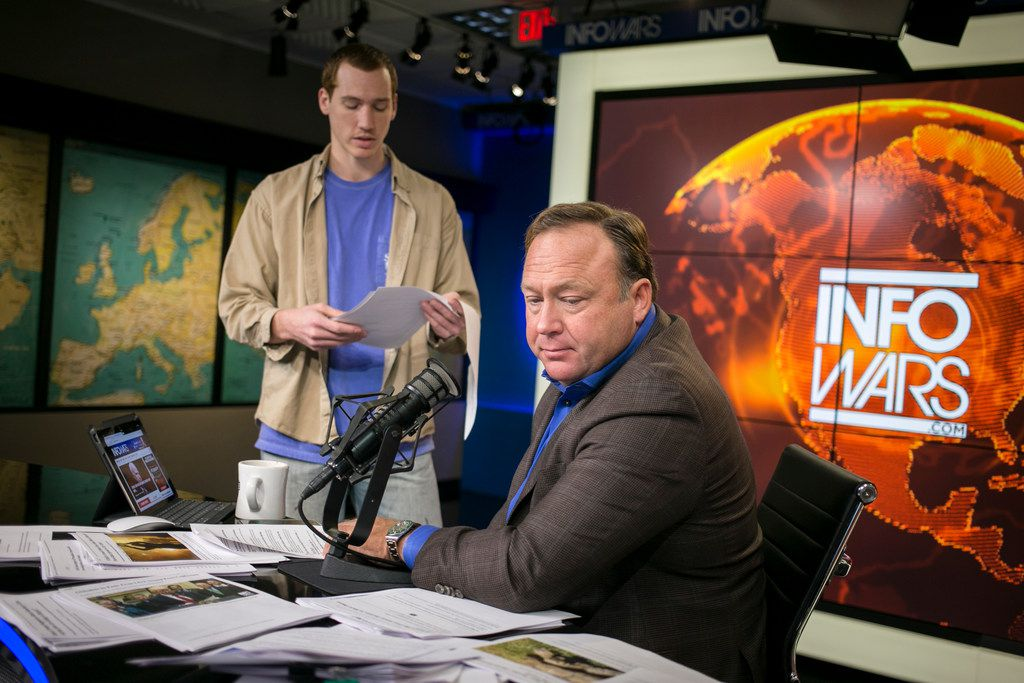 Alex Jones, the right-wing conspiracy theorist, before his show in Austin, Feb. 17, 2017. Over the past several days Apple, Facebook, YouTube and Spotify have removed most of Alex Jones' programming from their services.