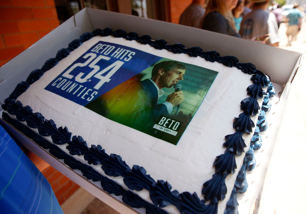 A volunteer carried a cake during Saturday's town hall in Gainesville.