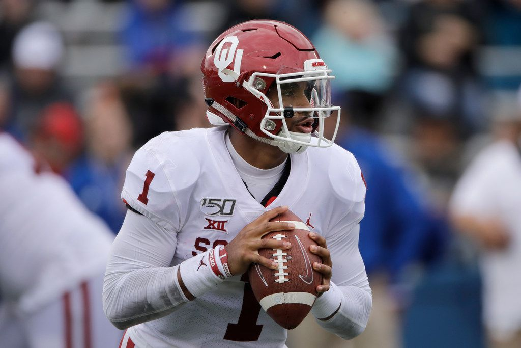 Oklahoma quarterback Jalen Hurts (1) looks for a receiver during the second half of an NCAA college football game against Kansas Saturday, Oct. 5, 2019, in Lawrence, Kan. (AP Photo/Charlie Riedel)