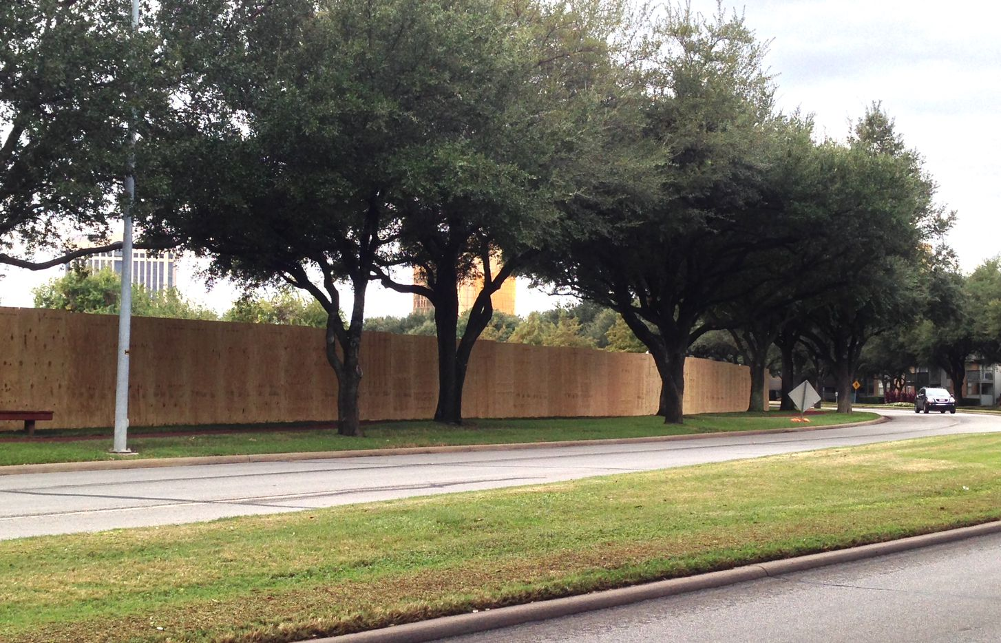 Construction fencing stretches along Southwestern Boulevard in The Village.