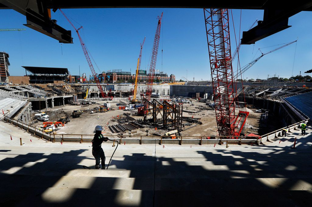 Construction worker Tevin Bias winds up a cord as he works on the main concourse seating behind home plate at the new Globe Life Field under construction in Arlington. The Texas Rangers celebrated the One Million Man Hours by providing a barbecue lunch for its nearly 900 construction workers.