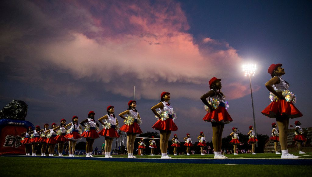Duncanville dance team members stand at attention before a high school football game between Skyline and Duncanville on Friday, October 4, 2019 at Panther Stadium in Duncanville. (Ashley Landis/The Dallas Morning News)