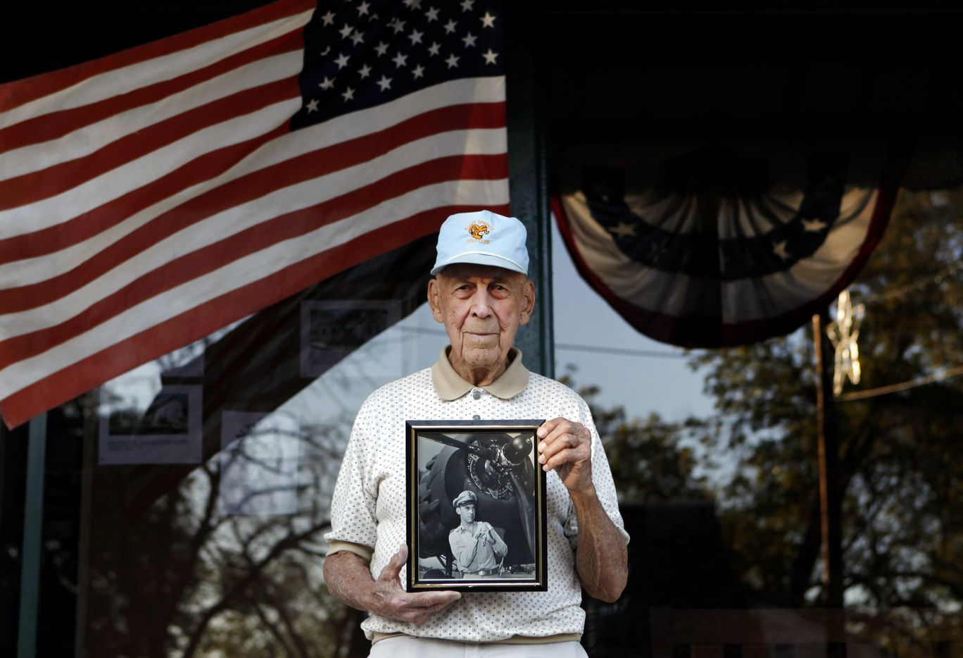 Lt. Col. Richard E. Cole, 97, who was the co-pilot on the famous Doolittle Raid on April 18, 1942 over Japan, a retaliatory strike for Pearl Harbor, holds a picture of himself taken in 1943 after returning home to the United States. Photographed in Comfort, Texas on Wednesday, November 7, 2012.  (Lara Solt/The Dallas Morning News) 11112012xNEWS