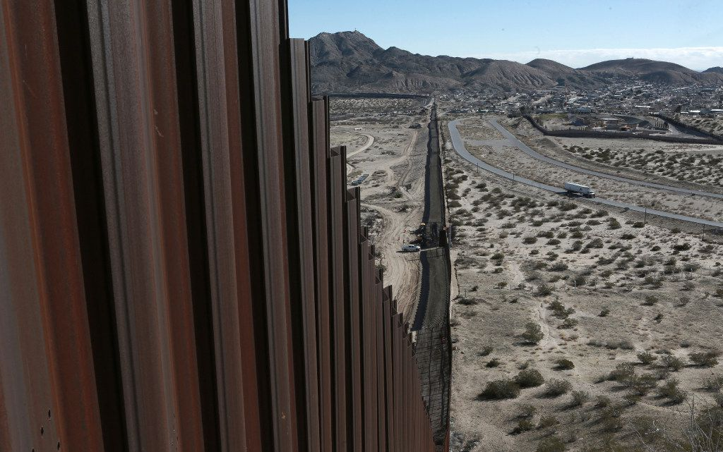 In this Wednesday, Jan. 25, 2017 file photo, a truck drives near the Mexico-US border fence, on the Mexican side, separating the towns of Anapra, Mexico and Sunland Park, New Mexico. A third of the U.S.-Mexico border is already studded with an assortment of fences. But closing off the rest will be no easy task. Much of the border through Texas is blocked by the Rio Grande or other natural barriers. Most all the Texas border land is private, and many landowners oppose the plan. (AP/Christian Torres, File)