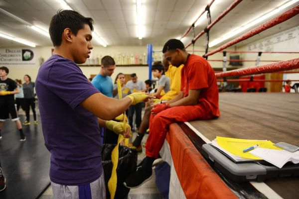 Hector Trujillo, 19, tapes up his hands before boxing practice.