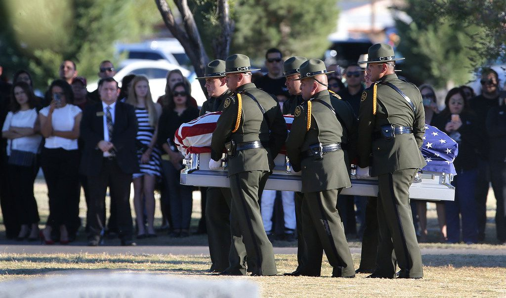 Border Patrol pallbearers carry Border Patrol agent Rogelio Martinez to a graveside service at Restlawn Cemetery on Saturday in El Paso.