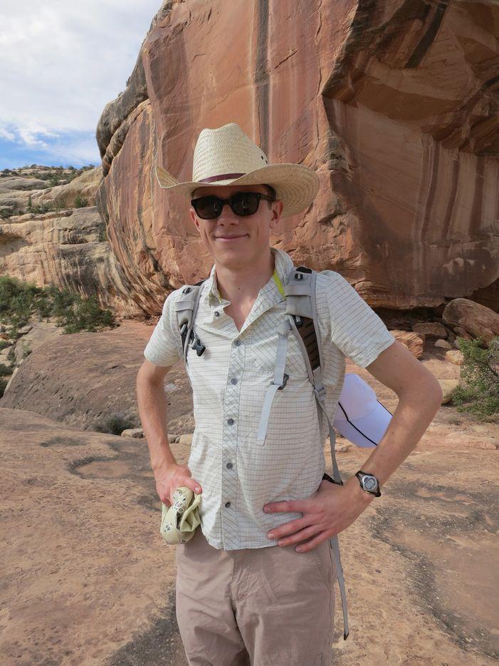 Jon posing for a photo in Natural Bridges National Monument in southeast Utah, summer 2012.
