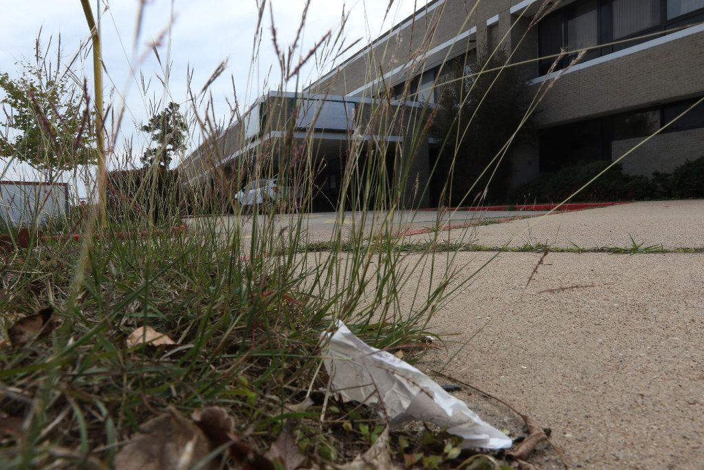 Weeds and trash cover the lawn of the rundown former Cleveland Regional Medical Center at 300 E. Crockett St. in Cleveland, Texas. on Nov 14, 2016.