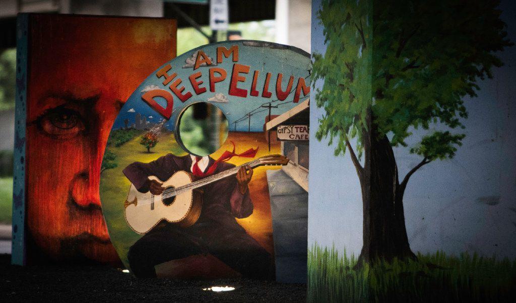 Art sits under a bridge near Good-Latimer Street in Deep Ellum in Dallas on Sunday, July 9, 2017.