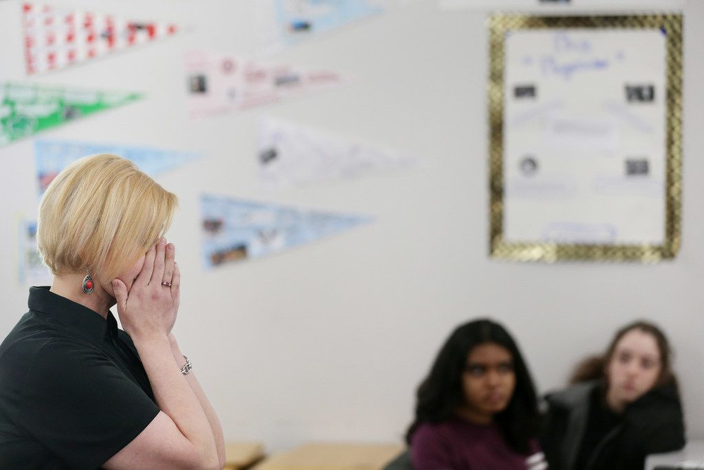 Choir teacher Allison Hartzell reacts while explaining the most difficult aspect of her cancer diagnosis, which she describes as the effect on her loved ones, during a class she visited at Coppell Middle School West.