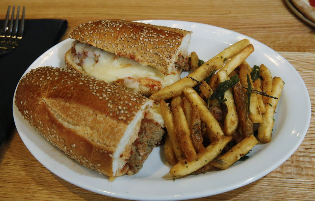 Meatball Parmesan Sandwich photographed Monday December 14, 2015, from the lunch menu of the new Coal Vines, located across from the Omni Dallas Hotel. Meatballs topped with whole milk mozzarella with Sea salt and cracked pepper fries. (Ron Baselice/The Dallas Morning News)