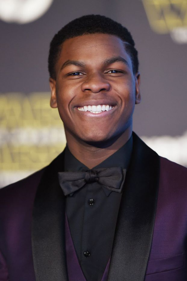 """HOLLYWOOD, CA - DECEMBER 14:  Actor John Boyega attends Premiere of Walt Disney Pictures and Lucasfilm's """"Star Wars: The Force Awakens"""" on December 14, 2015 in Hollywood, California."""