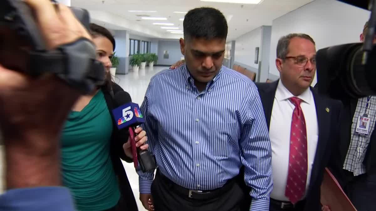 Wesley Mathews, adoptive father of Sherin Mathews, ignores questions as he leaves a court appearance at the Henry Wade Juvenile Justice Center in Dallas after a custodial hearing.