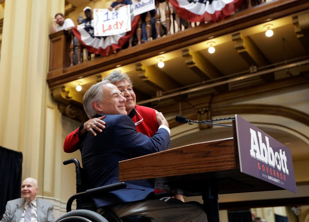 Texas Gov. Greg Abbott is hugged by his mother-in-law, Maria de la luz Segura Phalen, right, during a Friday rally where he announced his bid for re-election bid.