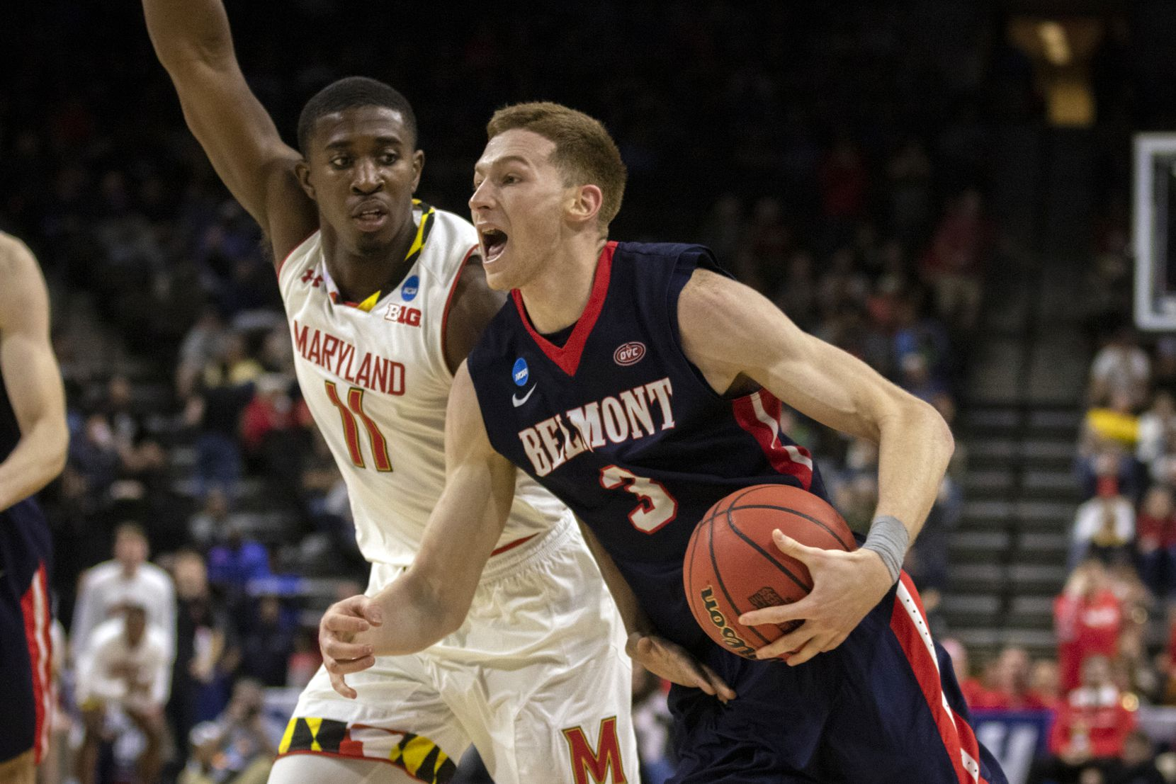 Belmont guard Dylan Windler (3) drives to the basket while being defended by Maryland guard Darryl Morsell (11) during the second half of the first round men's college basketball game in the NCAA Tournament, in Jacksonville, Fla. Thursday, March 21, 2019. (AP Photo/Stephen B. Morton)