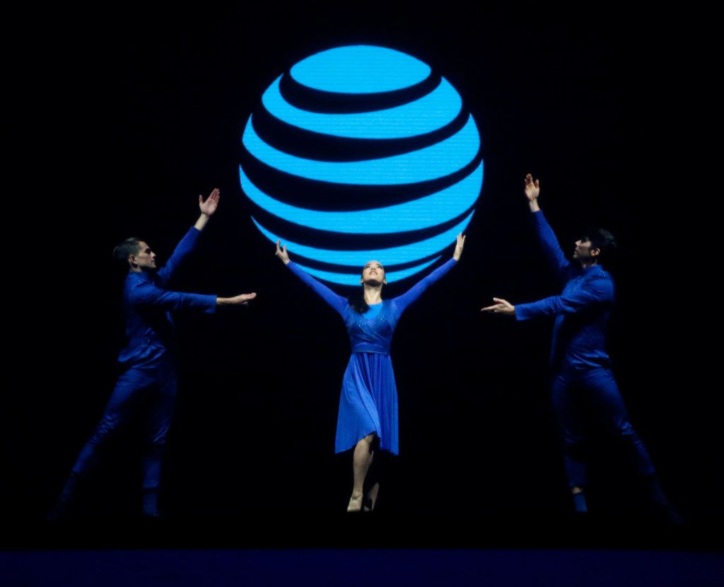 Performers dance in font of an interactive screen showing the AT&T logo at Gaylord Texan Resort & Convention Center in Grapevine, Texas on Sept. 27, 2018.  (Nathan Hunsinger/The Dallas Morning News/Pool)