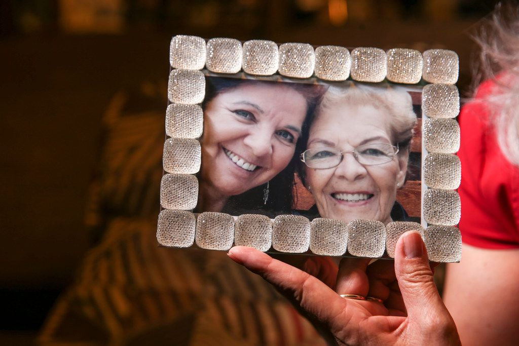 Rebecca Payan with a photograph of her mother, Ofelia Reyes.