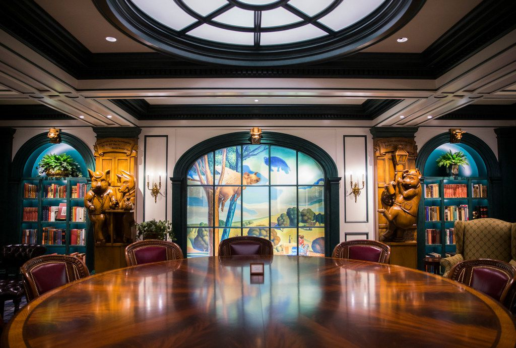 The Pig Room at Old Parkland is a whimsical meeting room with a pig theme outside the very serious Debate Room.