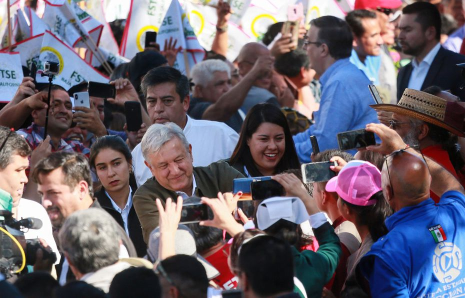 Mexican President Andres Manuel Lopez Obrador shakes hands with supporters during a unity rally on June 8 in Tijuana, Mexico.. Lopez Obrador committed to defending Mexico's dignity amid a looming threat from U.S. President Donald Trump, who has pledged to impose 5% tariffs on Mexican products unless the country prevents Central American migrants from traveling through its territory.