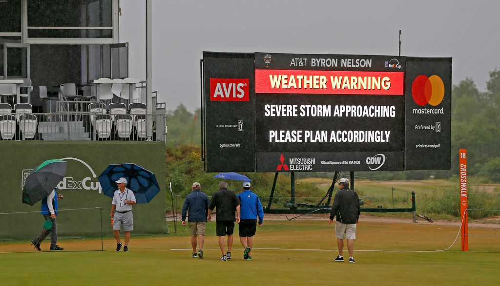 Fans cross the 18th fairway during a weather delay of the final round of AT&T Byron Nelson at Trinity Forest Golf Club in Dallas, Sunday, May 20, 2018. (Jae S. Lee/The Dallas Morning News)