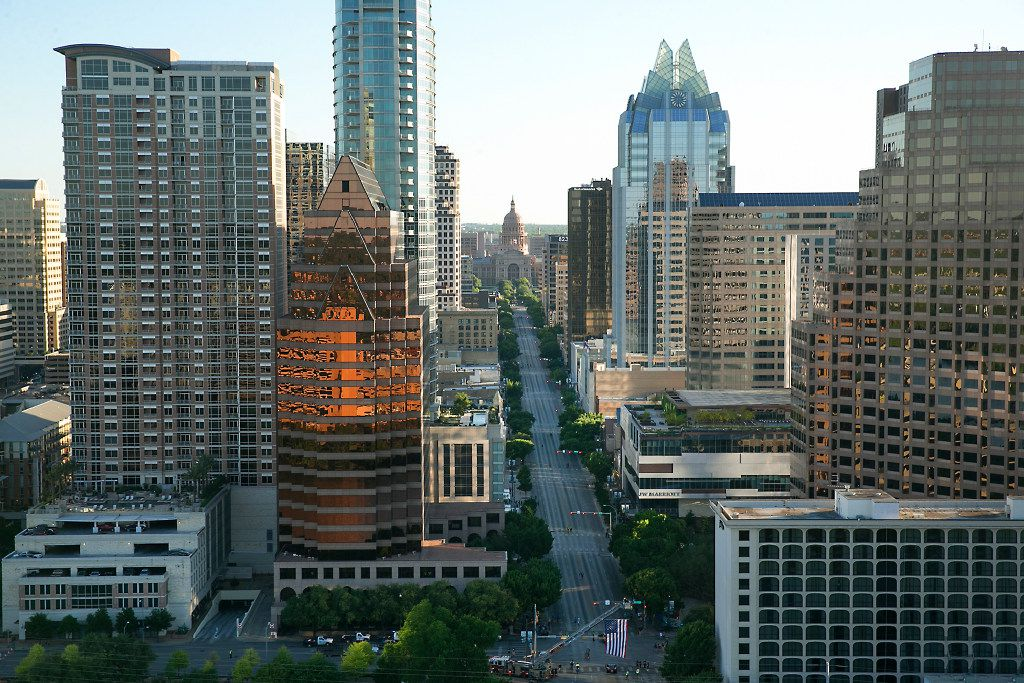 Aerial view of downtown Austin including the Texas Capitol up Congress Avenue.
