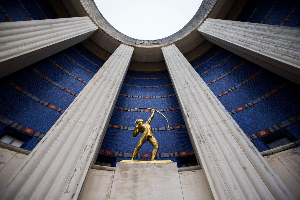 A gold leaf Tejas Warrior statue is paired with original blue tiles outside the historic Hall of State building on March 1, 2019 at Fair Park in Dallas. The building, originally built in 1936 ahead of the Texas Centennial Exposition, will soon begin a restoration. (Ashley Landis/The Dallas Morning News)