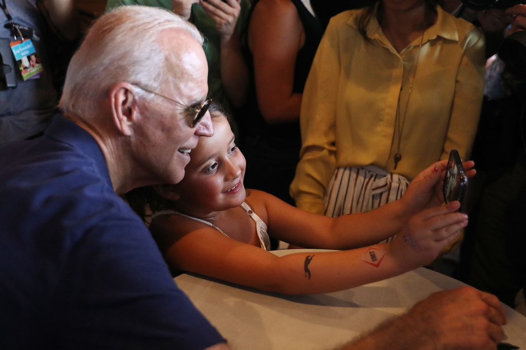 Former Vice President Joe Biden poses for selfies while stumping at the Iowa State Fair on Aug. 8, 2019, in Des Moines. 22 of the 23 politicians seeking the Democratic Party presidential nomination will be visiting the fair this week, six months ahead of the all-important Iowa caucuses.
