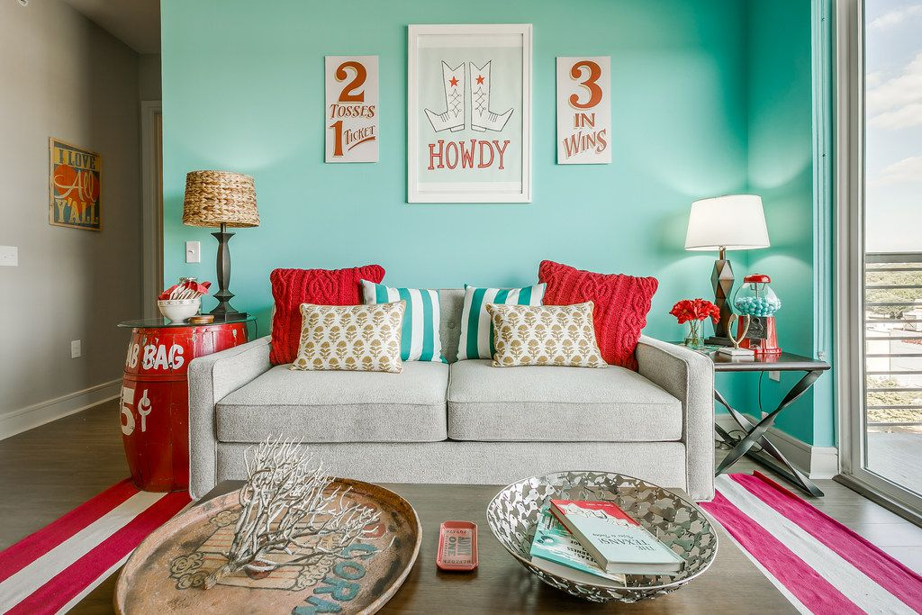 Lots of color and whimsy create a festive atmosphere in the State Fair-themed apartment designed by Courtney Warren.