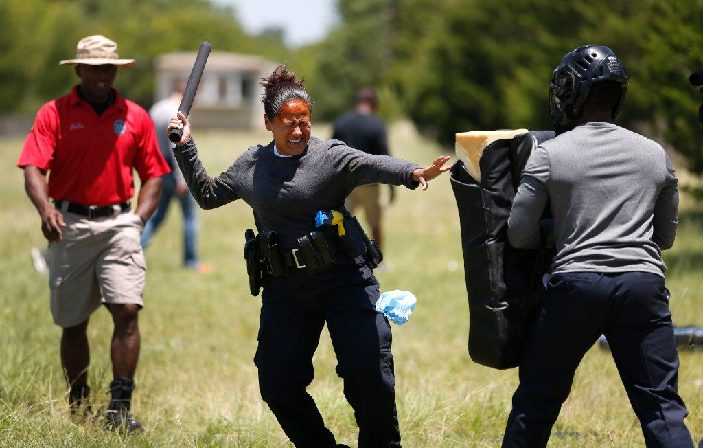 Police recruits 'put the cape on' for a Dallas force that