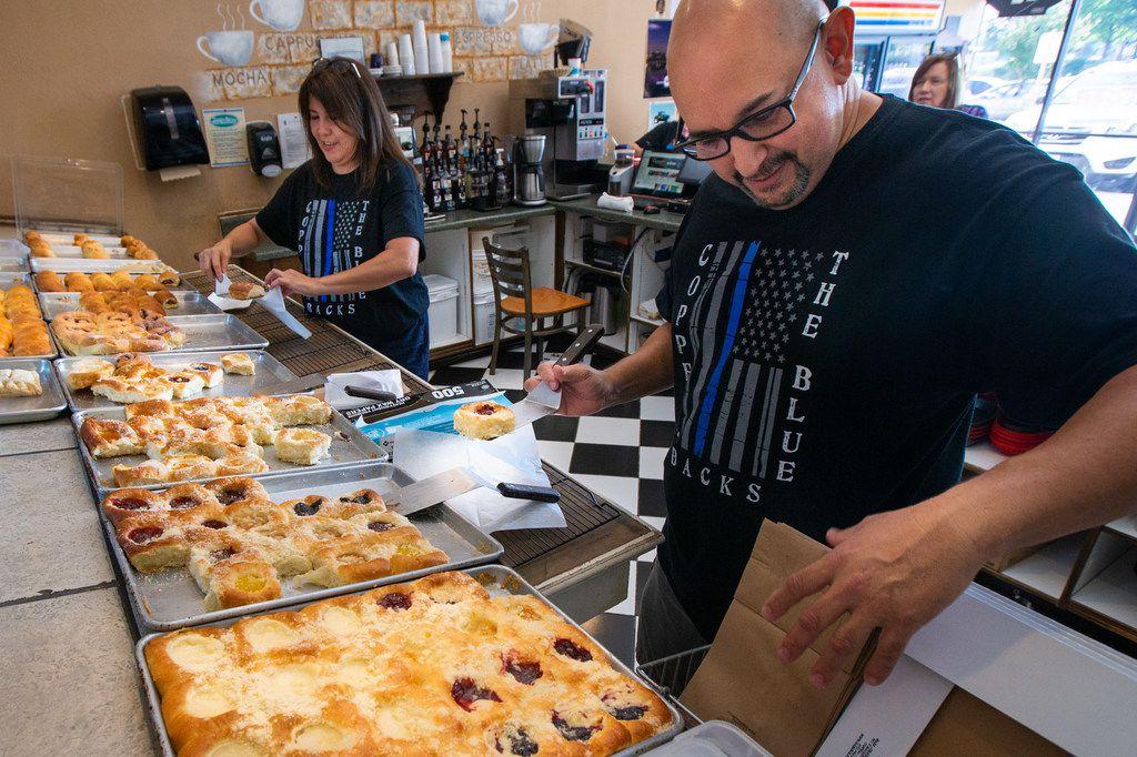 Kasa Kolache bakery owners Enrique Barrera (right) and Gloria Barrera prepare a kolache order for customers in Coppell, Texas, on Thursday, July 25, 2019. (Lynda M. Gonzalez/The Dallas Morning News)