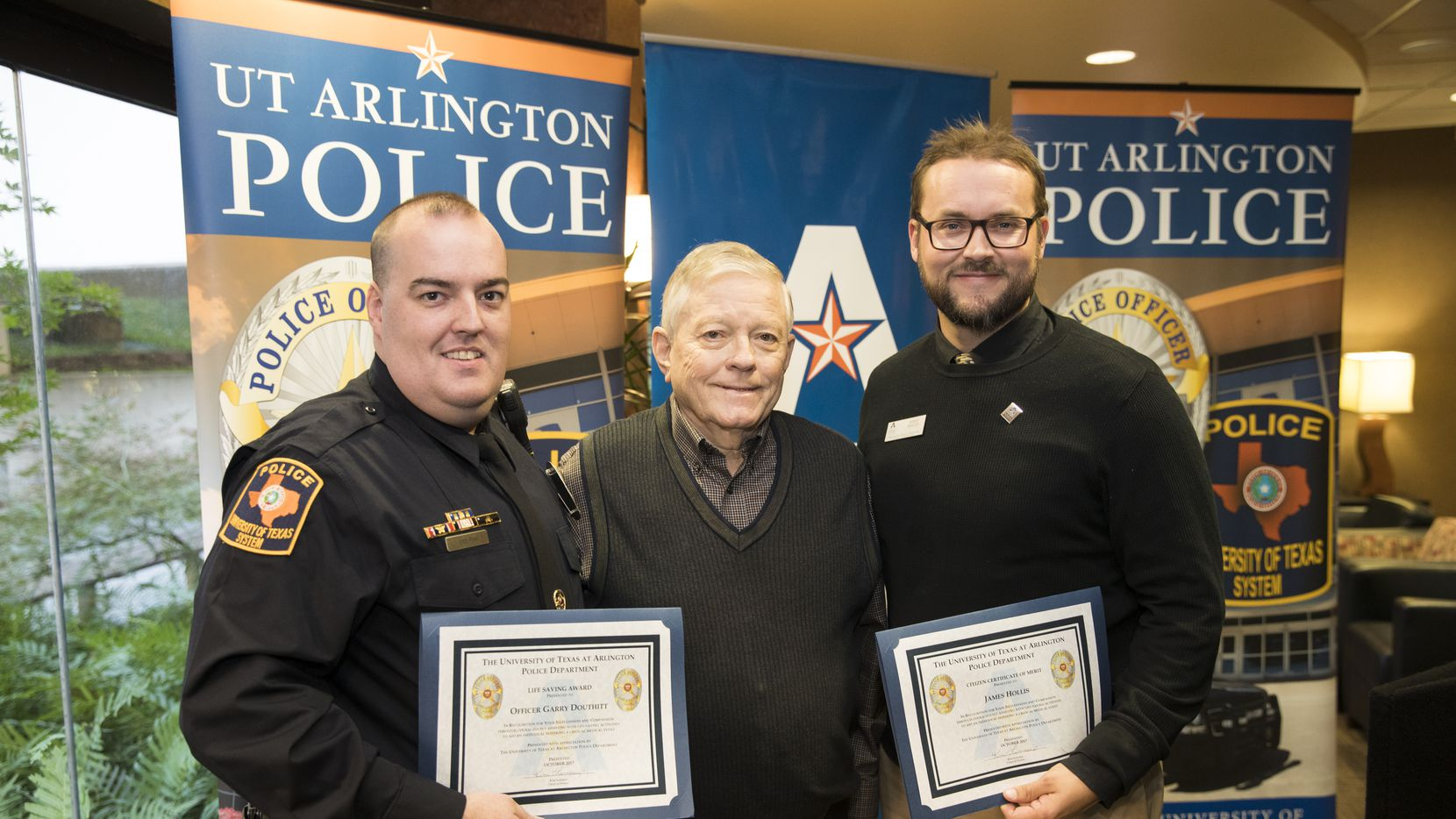 James Gamble (center) meets UTA police Officer Garry Douthitt (left) and James Hollis, the university's director of community partnerships, at a ceremony honoring the two for helping save Gamble's life during a campus function.
