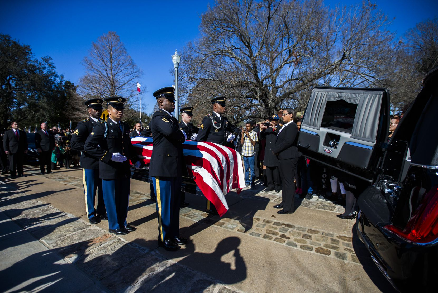 Honor guard members transport the remains of Richard Overton to his burial site the Texas State Cemetery on Saturday,