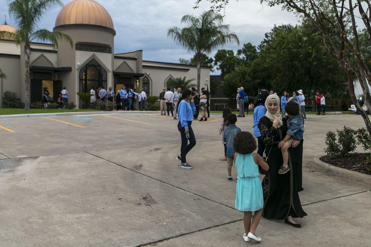 A family leaves from the newly rebuilt Victoria Islamic Center in Victoria, Texas, Saturday, Sept. 29, 2018. The new mosque rebuilt from more than $1 million raised by a Gofundme effort.  (Josie Norris/The San Antonio Express-News via AP)