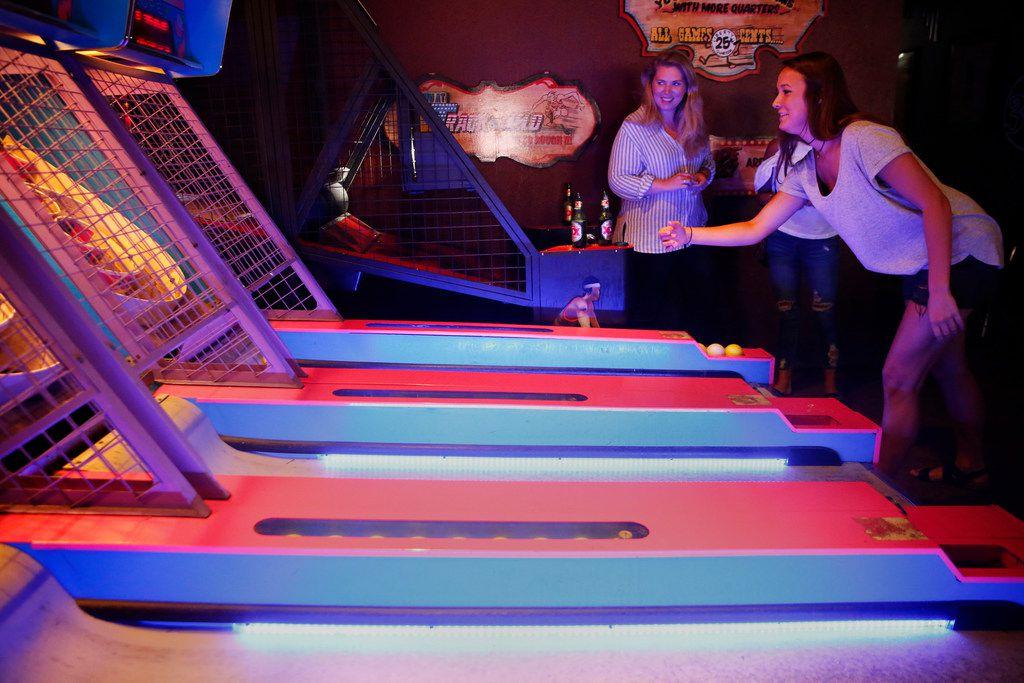 Caitlin Kender plays Skee-Ball at Barcadia in Dallas.