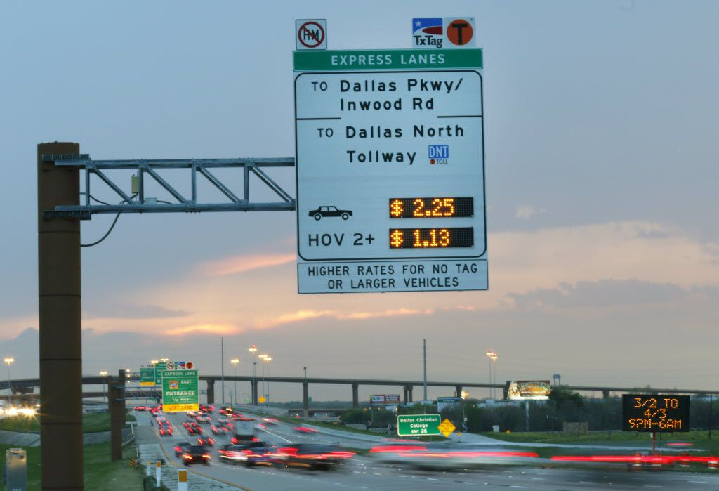 Tollway signs post the cost for travelers on the eastbound lane of LBJ. Under a plan unveiled Thursday, the toll lane discount for vehicles with two or more occupants will be replaced with a reward system.