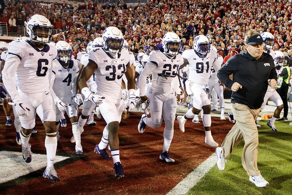 TCU head coach Gary Patterson leads his team onto the field before an NCAA football game against Oklahoma in Norman, Okla., Saturday, Nov. 11, 2017. (Smiley N. Pool/The Dallas Morning News)