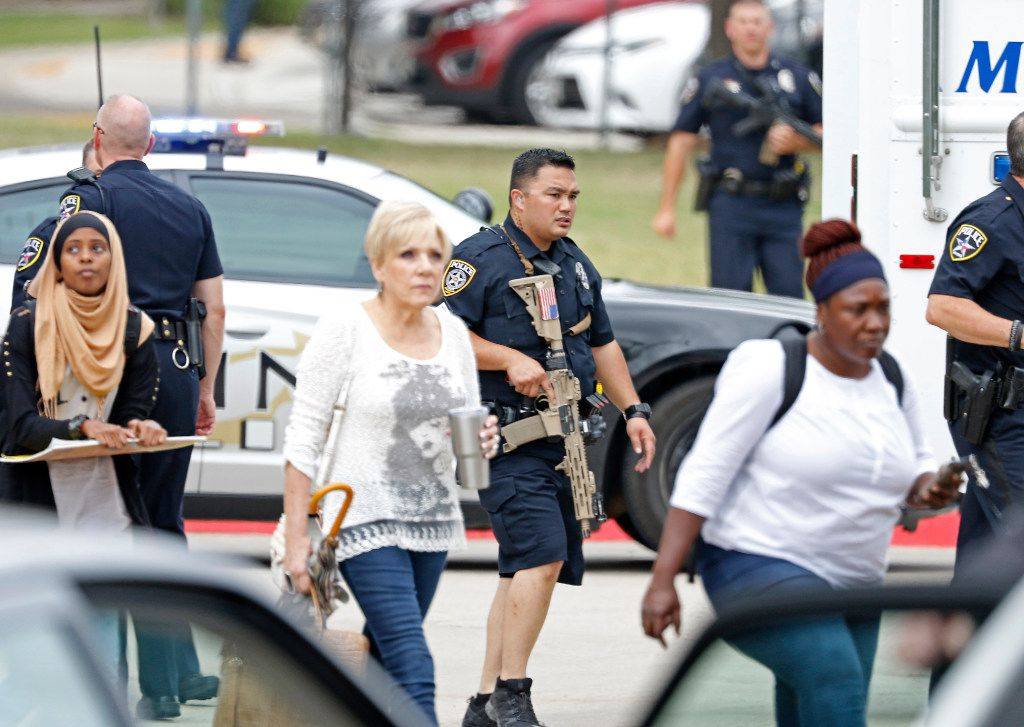 People walk out of a building at North Lake College campus in Irving.