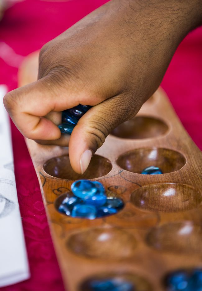 People play Sungka, a Filipino Mancala game, during the 27th Home Depot Asian Festival on Saturday, May 13, 2017 at Cotton Bowl Plaza in Dallas Fair Park.