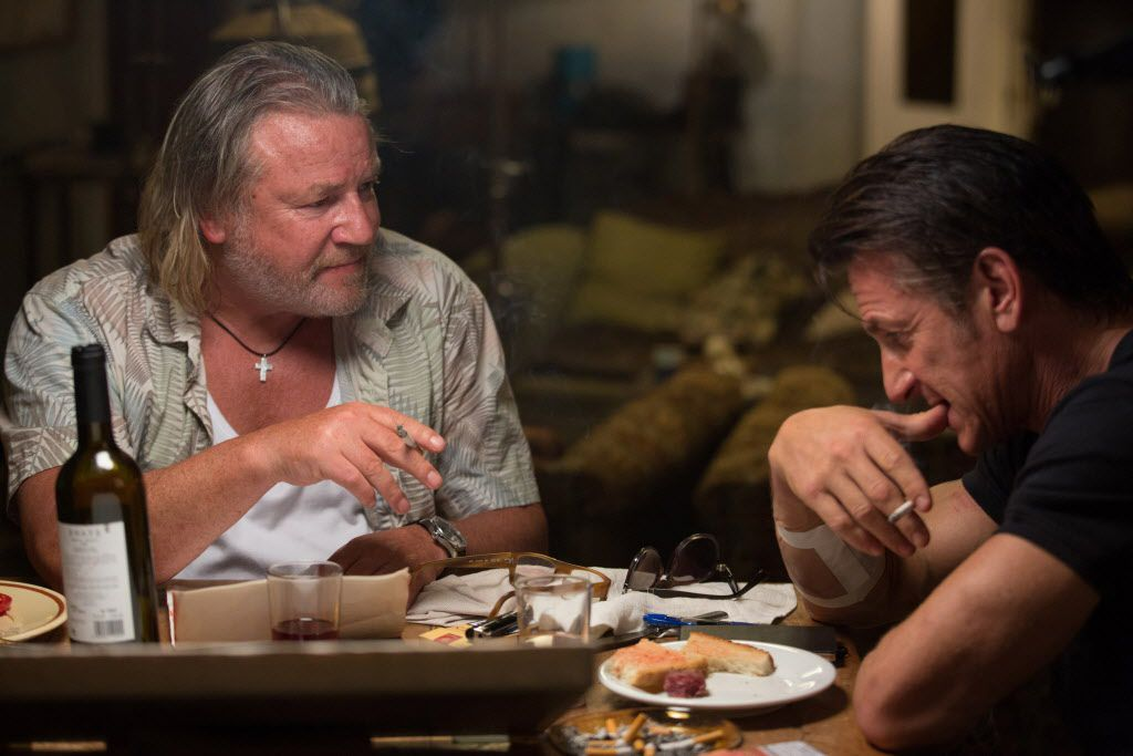"Ray Winstone as Stanley, left,  and Sean Penn as Jim Terrier in ""The Gunman."""