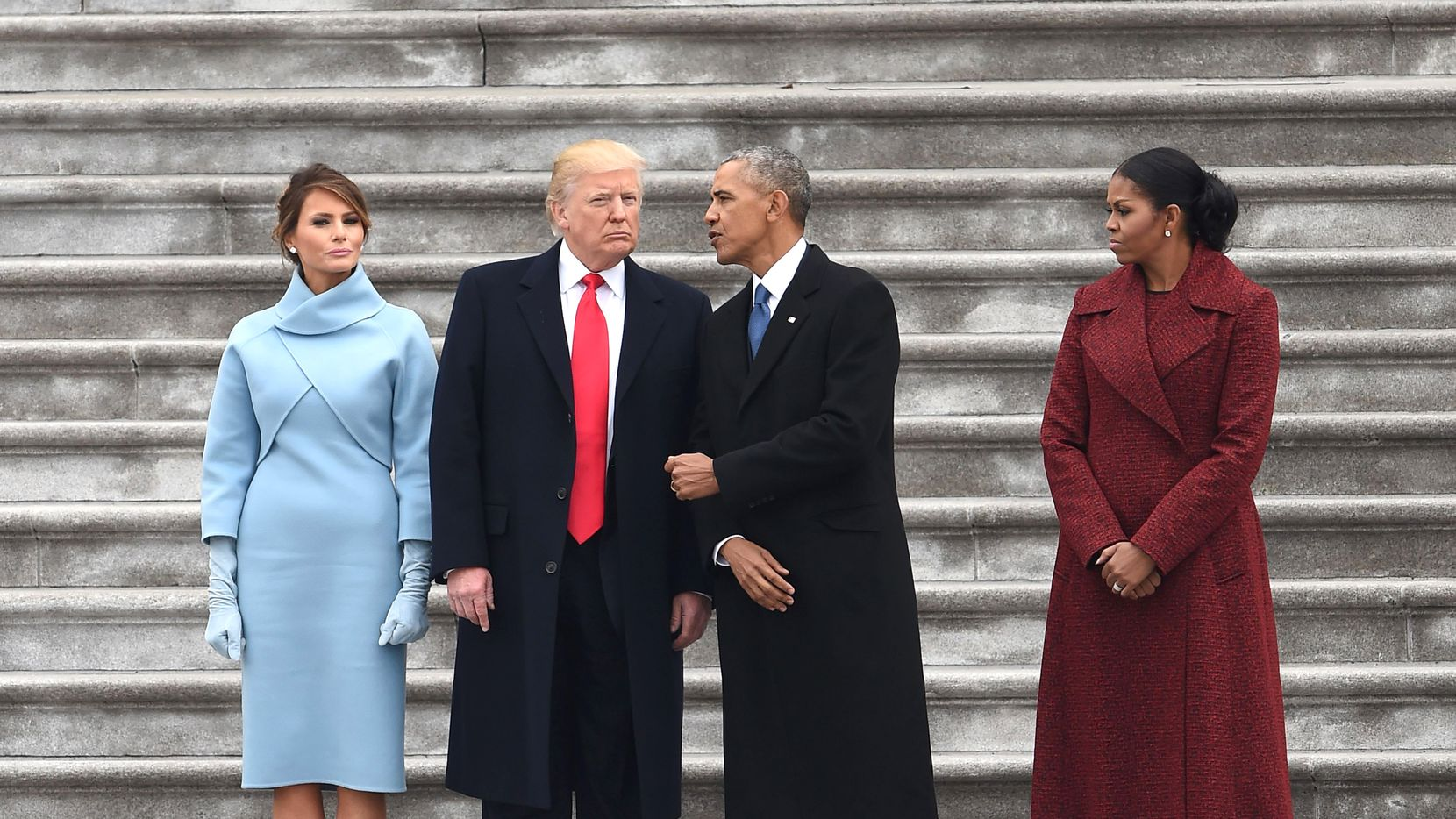 US First Lady Melania Trump and President Donald Trump stand with former President Barack Obama and Michelle Obama after inauguration ceremonies at the US Capitol on January 20, 2017 in Washington,