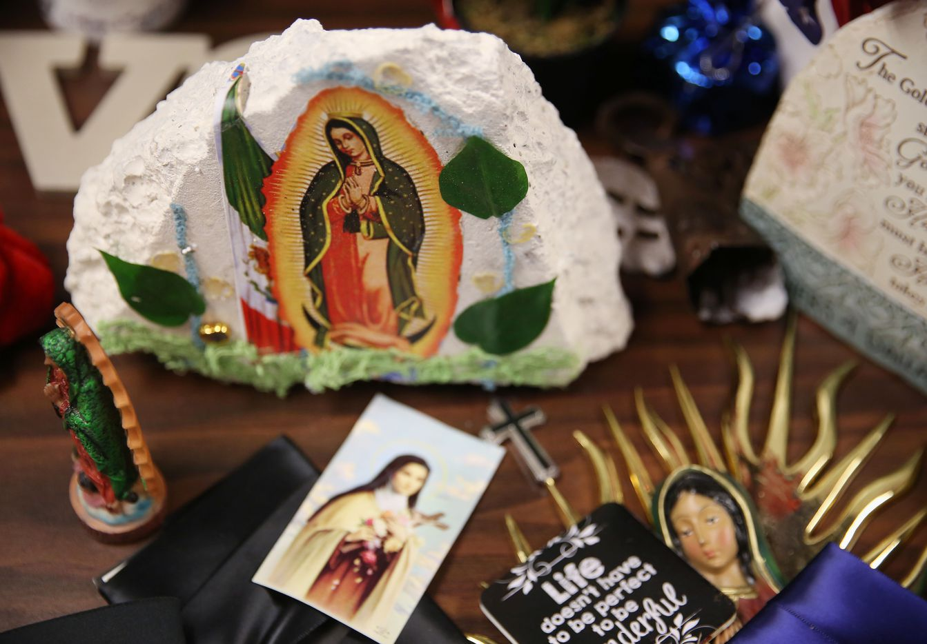 Religious artifacts from the makeshift memorial at the Dallas Police Department headquarters sitting at the J. Erik Jonsson Central Library.