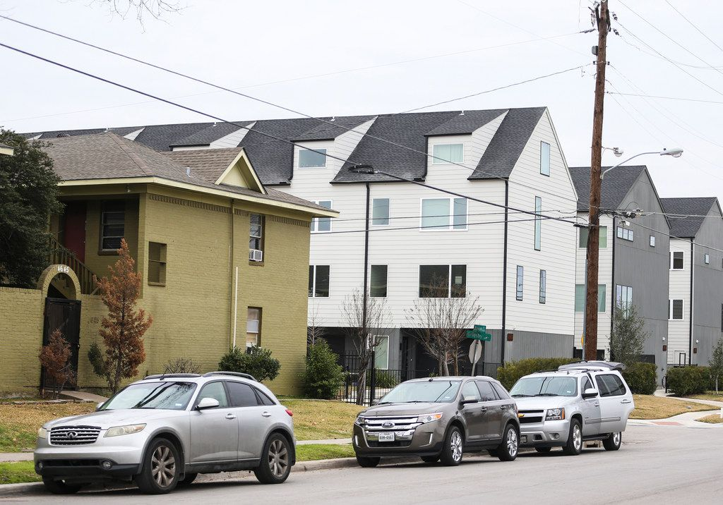 The Bryan Song Apartments, at left, in the shadow of the $340,000 condos across Grigsby Avenue.